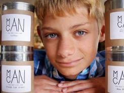 "Hart Main created  candles with ""man-friendly"" scents, such as coffee, sawdust,  new (baseball) mitt  and campfire, sold in recycled soup cans."