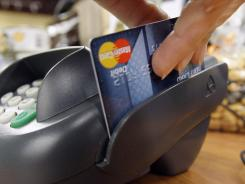 More banks are beginning to charge fees for purchases made with debit cards.