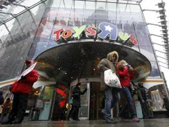 Shoppers leave the Toys R Us store in New York's Times Square last holiday season.