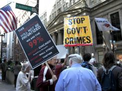 """Protesters gather on the corner of LaSalle and Jackson during an """"Occupy Chicago"""" protest Monday, Oct. 3, 2011, in Chicago."""