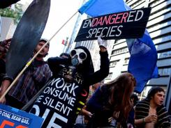 Protesters with Occupy Wall Street leave Zuccotti Park in New York Wednesday to join a rally at City Hall.