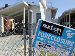 A foreclosure sign outside a home in Richmond, Calif., in April.