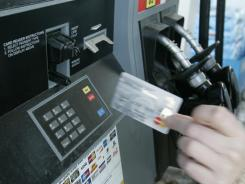 As the economy continues to struggle, some consumers are turning to credit cards.