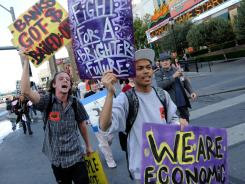 Protesters affiliated with the Occupy Las Vegas movement march on the Las Vegas Strip.