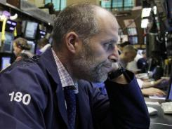 Trader Jason Weisberg works on the floor of the New York Stock Exchange.