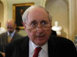 Sen. Carl Levin talks with the media on Capitol Hill in July 2010.