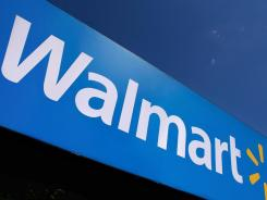 In this file photo, the Wal-Mart logo is displayed in Springfield, Ill.