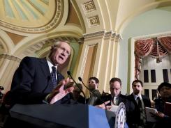 Senate leader Harry Reid talks to reporters in the Capitol on Wednesday about the trade bills.
