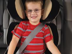 This shows a good belt fit on a booster seat, according to the Insurance Institute for Highway Safety. One key: The lower belt sits flat across the upper thighs, not the abdomen.