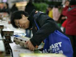 A Chinese customer inspects a carton of eggs at a Wal-Mart branch in Beijing in this file photo.