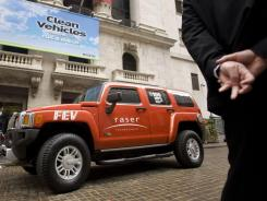 A modified Hummer H3 with a hybrid design by Raser Technologies is parked outside the New York Stock Exchange in May 2009.