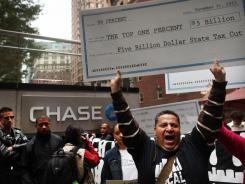 """Occupy Wall Street"" protesters march in front of the Chase Manhattan Bank headquarters in New York City on Wednesday."