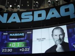 A display at the Nasdaq exchange's Times Square MarketSite on Oct. 6 honors the late Apple and tech icon Steve Jobs.