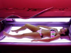 A new federal tax on indoor tanning services isn't bringing in as much revenue as hoped, a report says.