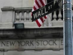 A street sign for Wall Street is seen outside of the New York Stock Exchange.