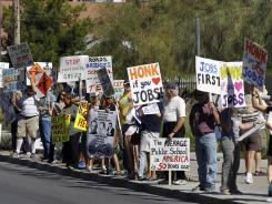 People rally for jobs at the federal courthouse Oct. 13, 2011, in Las Vegas. Nevada's unemployment rate is highest in the nation.