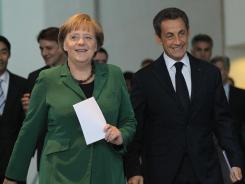 French President Nicolas Sarkozy and German Chancellor Angela Merkel in Berlin for talks on Europe's banking system  on Oct. 9,  2011.