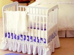 Bumper pads are cushions that attach to the slats of a crib above the mattress, as shown here.