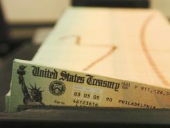 A tray of Social Security checks waits to be mailed in this file photo.