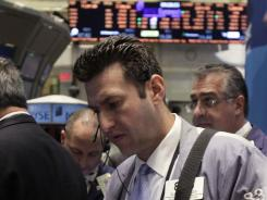 Traders work on the floor of the New York Stock Exchange Oct. 18, 2011.