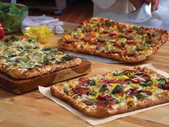 "Domino's is using the term artisan ""with a wink and a smile,"" says Russell Weiner, chief marketing officer of the pizza chain."