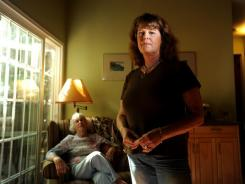 Victoria Froelicher's income is considered middle-class by the Census, but she is underwater on her house, supports her elderly mother and has a daughter in college. She's living hand to mouth and barely making it, she says.