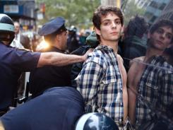 Police officers arrest an Occupy Wall Street protestor Friday, Oct. 14, 2011, in New York.