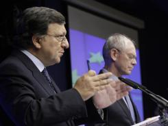 European Commission President Jose Manuel Barroso, left, and European Council President Herman Van Rompuy take part in a news conference after an EU summit in Brussels on Thursday.
