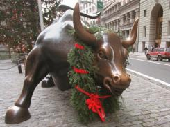History shows November and December are typically two of the strongest months for stocks. The iconic bull statute in the financial district of New York is seen here decorated for the holidays.