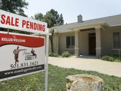 In this file photo, a pending sale sign is displayed in front of a home in Little Rock. Ark.