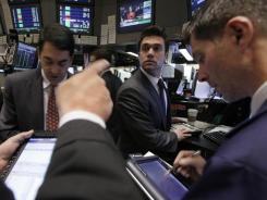 Traders work on the floor of the New York Stock Exchange Oct. 27, 2011.