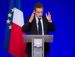 French President Nicolas Sarkozy speaks Thursday in Brussels.
