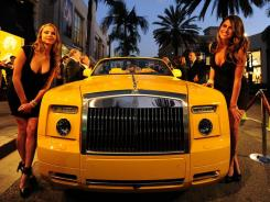 Models unveil a limited-edition Rolls-Royce Phantom on Oct. 6 at the Rodeo Drive Boutique in Beverly Hills, Calif.