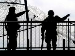 U.S. soldiers on a bridge to Baghdad airport in 2004.