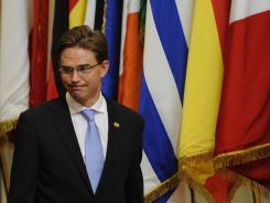 Finnish Prime Minister Jyrki Kaitanen grimaces last week during debt deal talks at EU headquarters in Brussels.