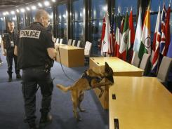 A police officer and his dog conduct a security sweep Monday in a conference room where G-20 leaders will gather Thursday for a summit in Cannes, France.
