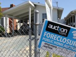 A foreclosure sign in April by a home in Richmond, Calif.