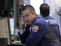 Christopher Culhane works at the post that handles Citigroup stock on the floor of the New York Stock Exchange Nov. 1, 2011.