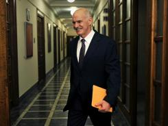 Greek Prime Minister George Papandreou arrives for a Cabinet meeting at the Greek parliament in Athens on Tuesday.