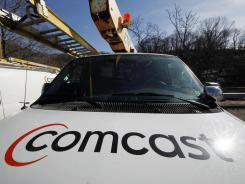 This Feb. 15, 2011 file photo shows a Comcast logo on a Comcast installation truck in Pittsburgh.