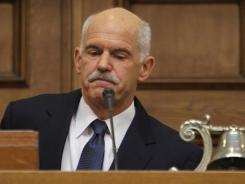 Greek Prime Minister George Papandreou addresses Socialist members of parliament in Athens on Monday.