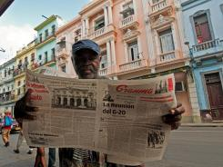 A man reads the Granma newspaper announcing the new housing law, on Nov. 3, 2011 in Havana.