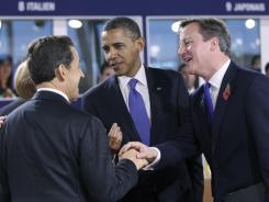 In Cannes, France:  From left, Germany's Angela Merkel, France's Nicolas Sarkozy, President Obama and Britain's David Cameron.