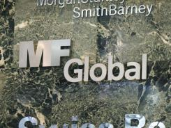 A sign for MF Global is displayed at an office building Wednesday in New York.