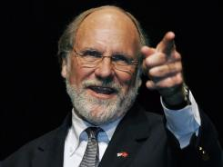 In this July 25, 2009 file photo, Jon Corzine, then governor of New Jersey, gestures as he addresses a crowd in Englewood, N.J.