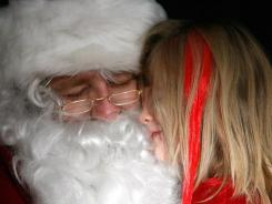 A mall Santa in Dubuque, Iowa, greets a 5-year-old visitor in 2010.
