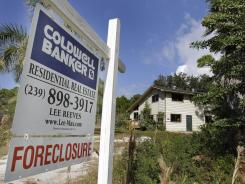 A foreclosed home is shown on Pine Island in Lee County, Fla., in 2010.