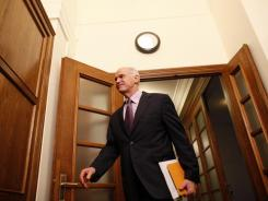 Greece's Prime Minister George Papandreou arrives for a Cabinet meeting Sunday in Athens. Greek leaders struggled for a second day to end a political crisis.
