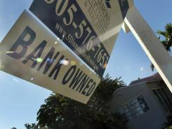 "A ""bank owned"" sign in December in front of a foreclosed home in Miami."