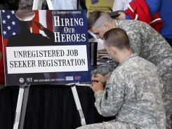 Veterans register for the 'Hiring Our Heroes' job fair at the South Towne Expo Center in Sandy, Utah.